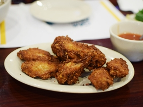 The deep fried chicken wings are likewise decent---they're served with a spicy dipping sauce.