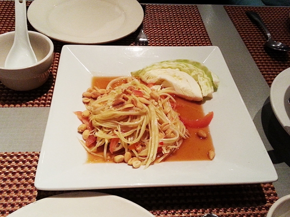 There's a regular papaya salad on the menu too, served sans any accompaniments, and that's the only difference.