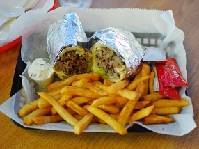The gyro comes in various incarnations. Here in a pita roll with fries.