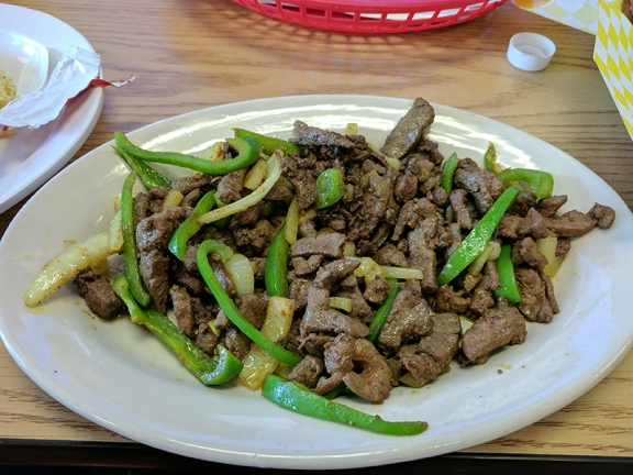 At our most recent meal our favourite dish may have been the fried liver (with onions and green peppers) that one of our friends got. The liver was cooked perfectly---crisped on the outside but still tender on the inside.