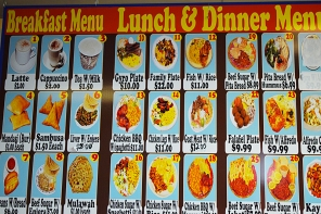 The menu is on the wall above the counter. You make your selections, order and pay and the food is brought to your table as it becomes ready. Don't be surprised if the pictures on the menu don't always resemble the actual dishes very closely.
