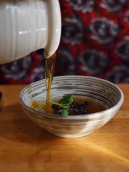 A holdout from the New Year's Weekend menu, the consomme was poured over chicken liver, almond oil and black trumpet mushroom.