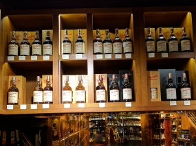 Above the cashier's desk are a bunch of Glenfarclas Family Casks