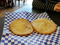 A sweet, doughy flatbread made, they said, with wheat flour, rice flour and sugar syrup. They didn't say that it is also fried in a liter of oil. But you can get a lot of the oil off by blotting it with a napkin. It's very good anyway.