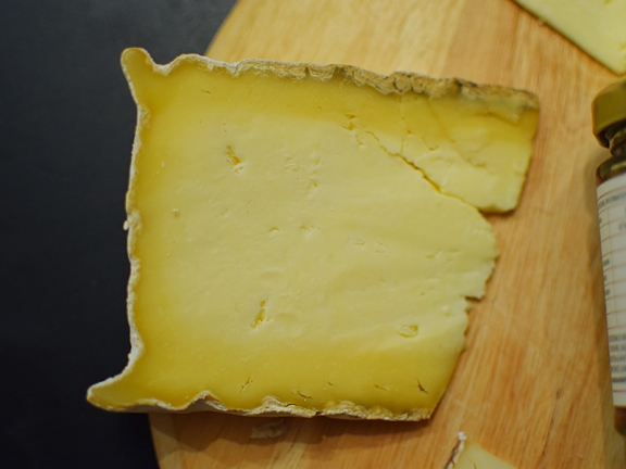 This is the stuff—creamier and funkier near the rind (a very thin layer) and milder and crumblier near the middle—pretty much as advertised—developing citrussy, grassy notes as it goes. Lovely stuff and a bit of an all-rounder as it included hints of blue cheese notes near the rind with milder and then more acidic notes in the middle.