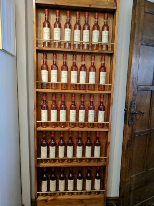 A wall of 500 ml bottles of vintage Armagnac from a producer by the name of Nismes-Delclou. I believe other than their own house bottlings these are the only Armagnacs they carry.