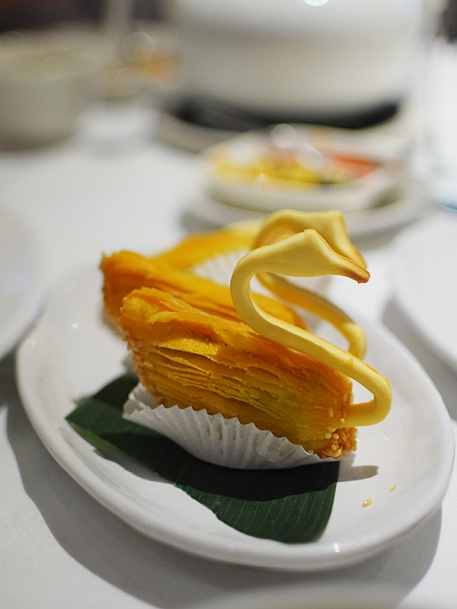 The flaky pastry contains duck even though it's shaped like a swan. Tasty but not as good as it looks.