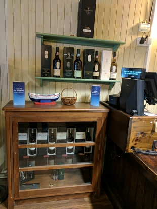 A few bottles of Port Ellen for sale near the cashier's desk. Very low-key.