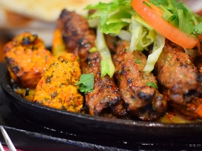 A closer look at the chicken tikka and mutton seekhs.