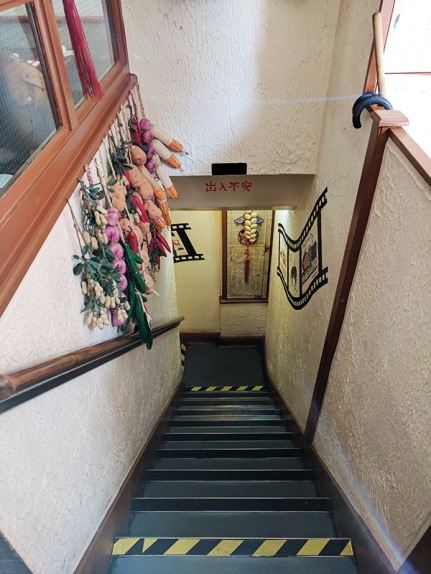 The stairs to the downstairs dining room are immediately to the right as you enter.
