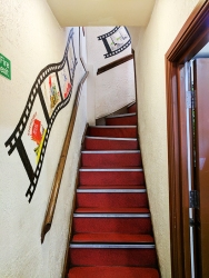 Narrow, winding stairs to the upstairs dining room.
