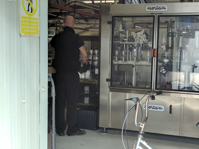And here's someone presumably cleaning the bottling equipment.