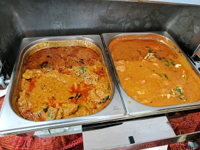 A rather good south Indian fish curry at left; decent chicken tikka masala at right.
