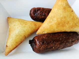The samosas/samboosas were very good if not very different from the Somali versions we've had. The sausage was described as Kenyan sausage.