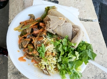 Stir-fried beef, with onions, peppers etc. Served with salad, rice and injera. Very good.