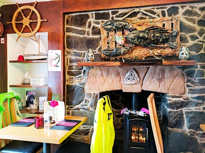 The Anchorage Bistro: Bicyclists' gear drying by the fire