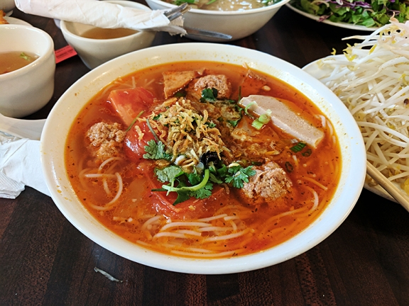 From the weekend menu this dish of rice noodles in tomato-based broth with forced meat, fried tofu and crab/pork balls is very good.