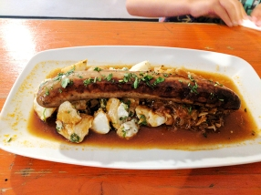 I think this was the käsekrainer, which might actually be an Austrian sausage. Served with Bavarian potatoes and decent sauerkraut.