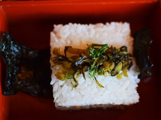 Another one whose description I just couldn't catch. A large block of rice with dried fish of some kind in the middle and greens atop. Very nice anyway.
