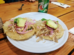 A sort of fluffy corn tortilla that kind of reminded me of Indian puris. Also topped with turkey, pickled onion and avocado.