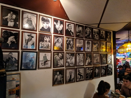 The wall near the restrooms are lined with pictures of stars