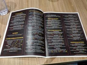 A flimsy paper menu.
