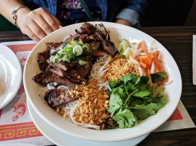 Bun bowl with grilled, marinated pork.