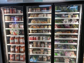 There's a large fridge and freezer section against one wall.