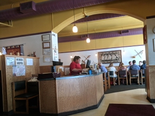 The brighter room on the other side of the cashier is where the buffet is.
