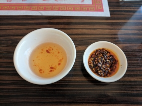 One or both of the fish sauce and chilli sauce come with most things. Both are very good.