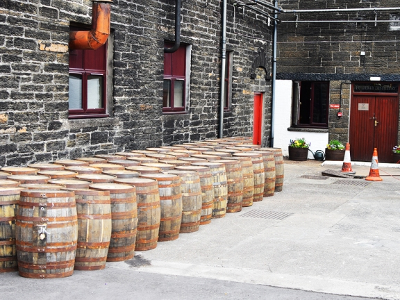 Empty casks outside the still house.