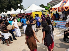 A seemingly impromptu performance in front of the Tamil booth.