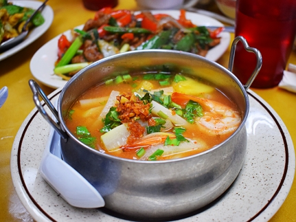 An excellent sweet and sour soup with shrimp and tender lotus root.