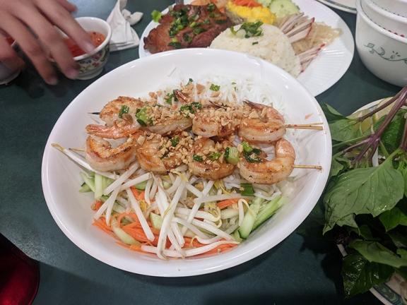 Grilled shrimp over rice noodles.
