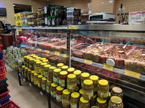 A deli counter on the left as you enter from the rear is the place to get your olives and feta and cold cuts.