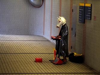 Hong Kong: Horse musician in pedestrian subway in Tsim Sha Tsui