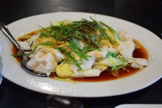 This is the regular steamed fish from the menu with ginger and lots of green onions.