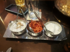 "On the left is a very good walnut and radish ""chutney"" with thick yogurt."