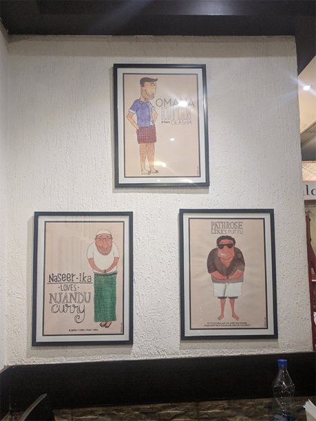 You may remember these cartoons on the walls of Just Kerala in Bombay as well. As to whether this means the restaurants are connected or just that the artist has cornered the market, I don't know.