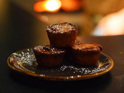 These complimentary pecan-corn muffins were far superior to the desserts we actually paid for.