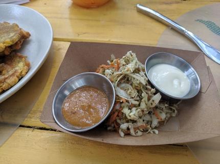 Pikliz or pickled cabbage, scotch bonnet salsa, crema