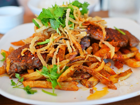 The fries under it get wonderfully seasoned.