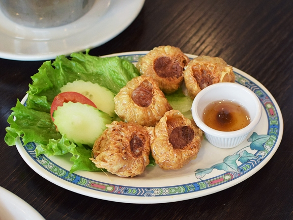 Crab, water chestnut etc. wrapped in a bean curd skin and fried.