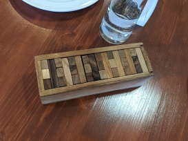 They have wooden puzzles set out on every table.