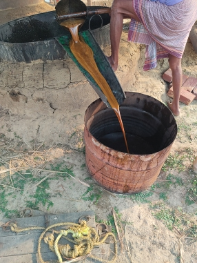 """This is the crucial part, the core of the ostad's skill: """"gur namano"""", where he tests the consistency of the thickened molasses and decides when exactly to take it off the fire. Too early can mean the wrong texture, and too late can give a slightly bitter taste to the jaggery."""