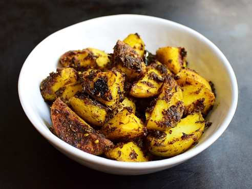 A dry preparation of spice-crusted potatoes.