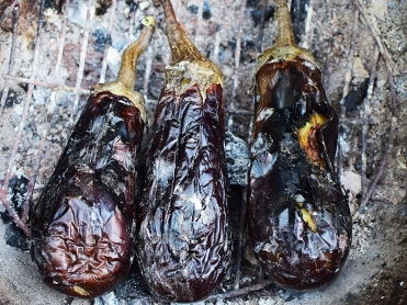 Three Nadias, charred over charcoal and used for bharta